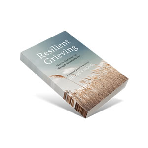 The cover of the book 'Resilient Grieving'. There is a blue sky above and a wheat field below.
